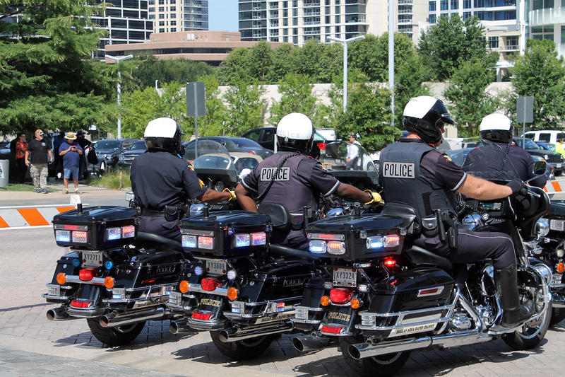 Police motorcycles lined up outside the memorial service in Dallas.