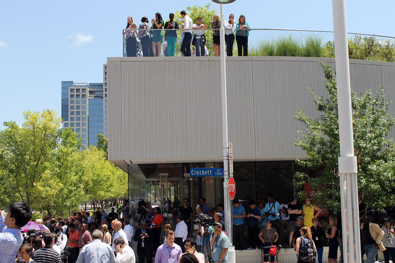 People stood on top of a roof across the street from the Meyerson.