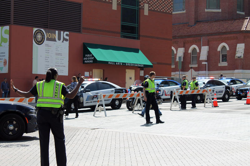 Police directed traffic before the memorial.
