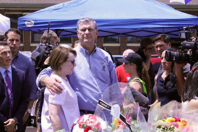 Mayor Mike Rawlings visits the memorial with his wife, Micki.