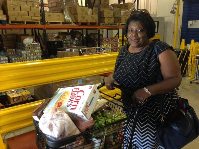 Shelecia Morris shops for food at Sharing Life Community Outreach in Mesquite.