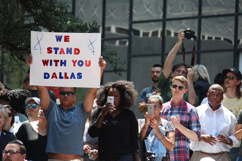 Dallas residents turned out to show support for law enforcement at a prayer vigil in Thanksgiving Square on Friday.