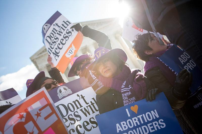 Lara Chelian, center, and her mother, Renee Chelian, both abortion providers from Michigan, hold signs in front of the U.S. Supreme Court in Washington, D.C., as Whole Woman's Health v. Hellerstedt is argued inside on March 2, 2016.
