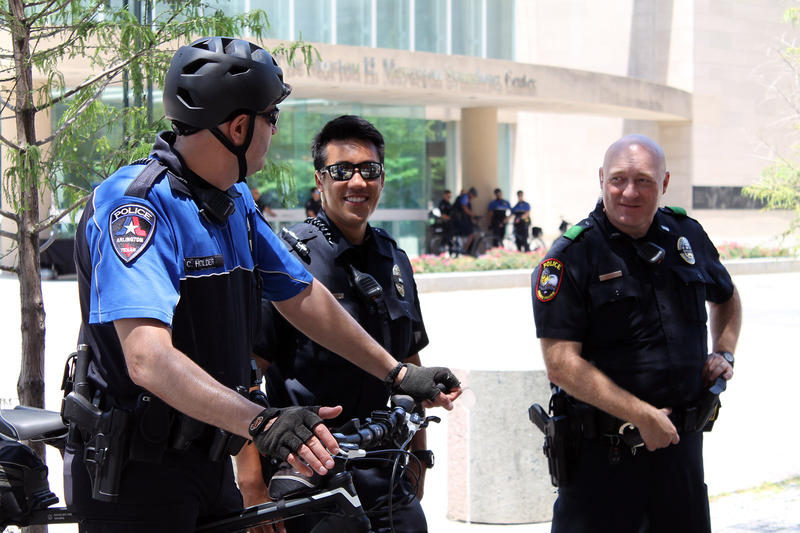 Arlington and Dallas police officers talked after the memorial service ended.