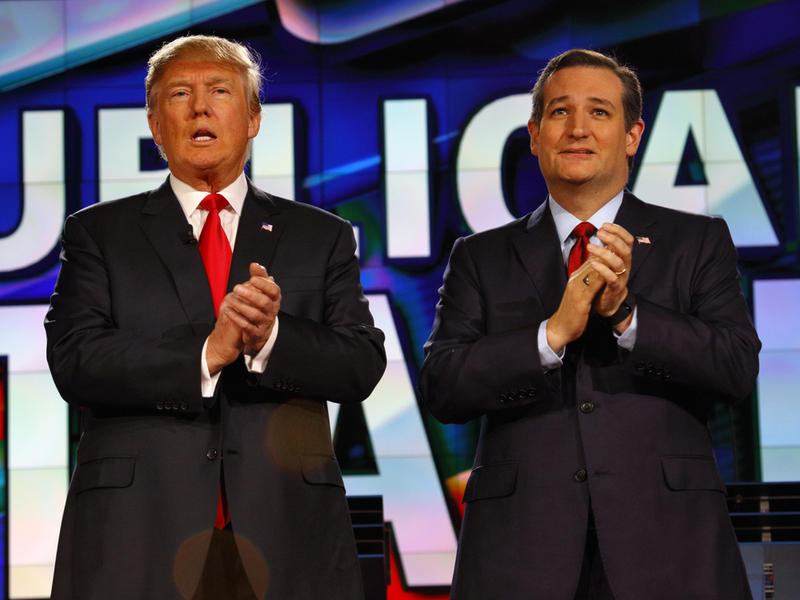 Republican presidential candidates US Senator Ted Cruz and Donald J. Trump clap at CNN republican presidential debate at The Venetian, December 15, 2015, Las Vegas, Nevada