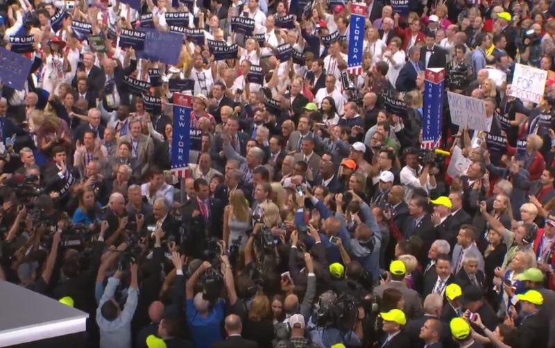 Cameras crowd around the Trump family at the moment Donald Trump Jr. announces the votes that clinched the Republican nomination for his father.