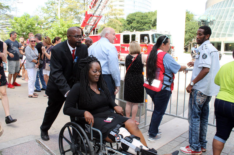 Shetamia Taylor, a civilian wounded by the attack in Dallas Thursday, is wheeled into the Meyerson.