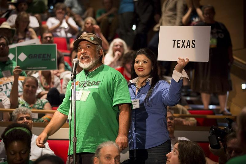 Texas delegate Herb Gonzales Jr. announces the state's votes for president at the Green Party's national convention in Houston on Saturday.