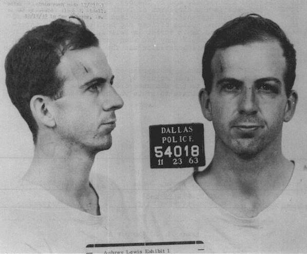 The recently completed mural of Lee Harvey Oswald in Oak Cliff is a painting of the right side of this photo — his mug shot following the murder of John F. Kennedy on Nov. 22, 1963.