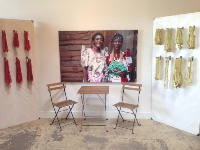 A potrait of Akola workers in Uganda hangs in the Deep Ellum shop.