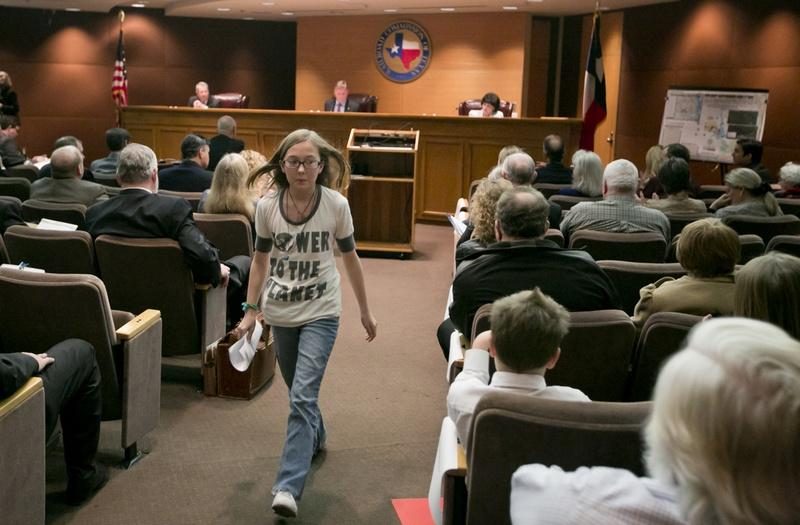 Kaylen Holmesly, a 7th grade resident of Azle, Texas, testifies before the Texas Railroad Commission and voiced her concern about an increased number of earthquakes around Eagle Mountain Lake on Jan. 21, 2014.