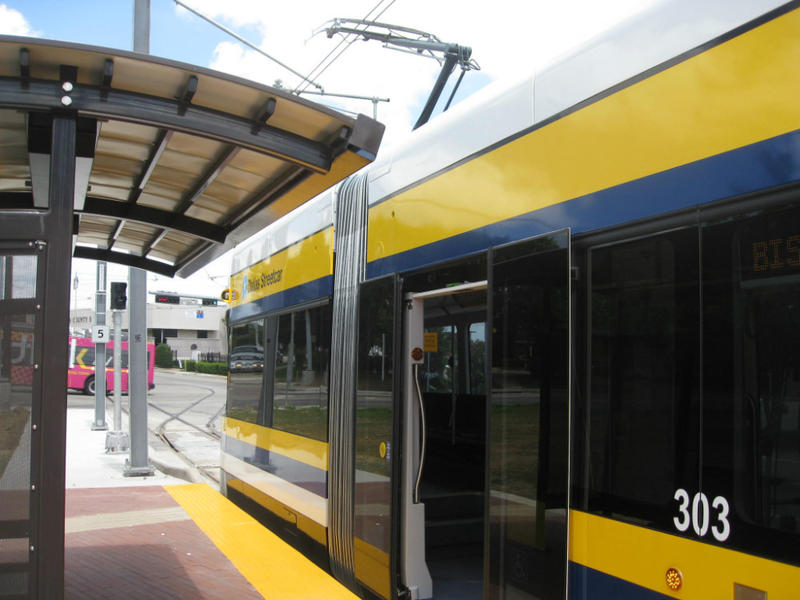 Dallas' downtown streetcar at the newest Oak Cliff stop in the Bishop Arts district. The free line now transports riders to Methodist Hospital and then to a popular business destination.
