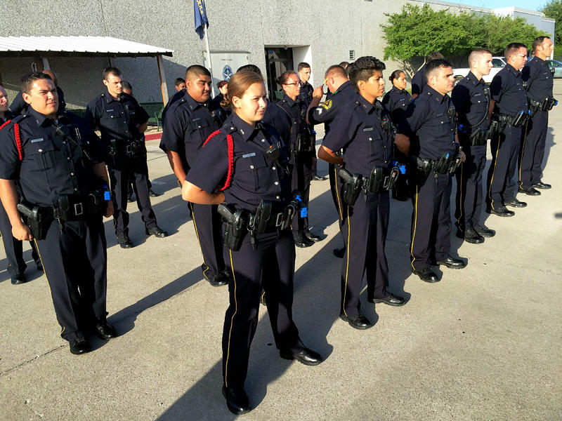 A class of recruits lines up for uniform inspection.