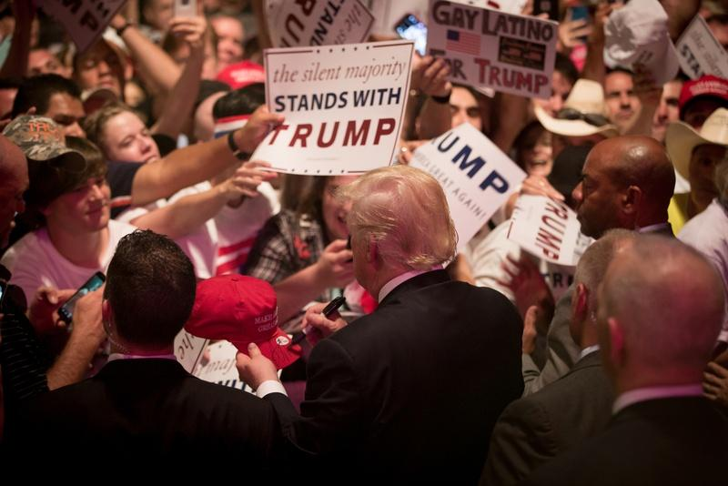 Donald Trump signs posters after his speech at a June rally at Gilley's in Dallas.