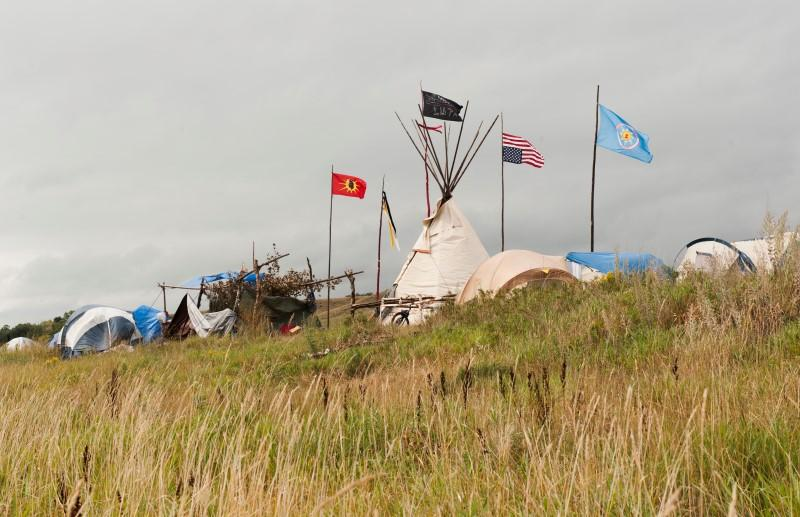 Tepees stand in the Seven Council camp, one of three encampments that have grown on the banks of the Cannon Ball River