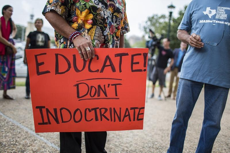 Hispanic activists, advocates and elected officials protested a proposed Mexican-American studies textbook on Tuesday ahead of the Texas Board of Education's first public hearing on the text.