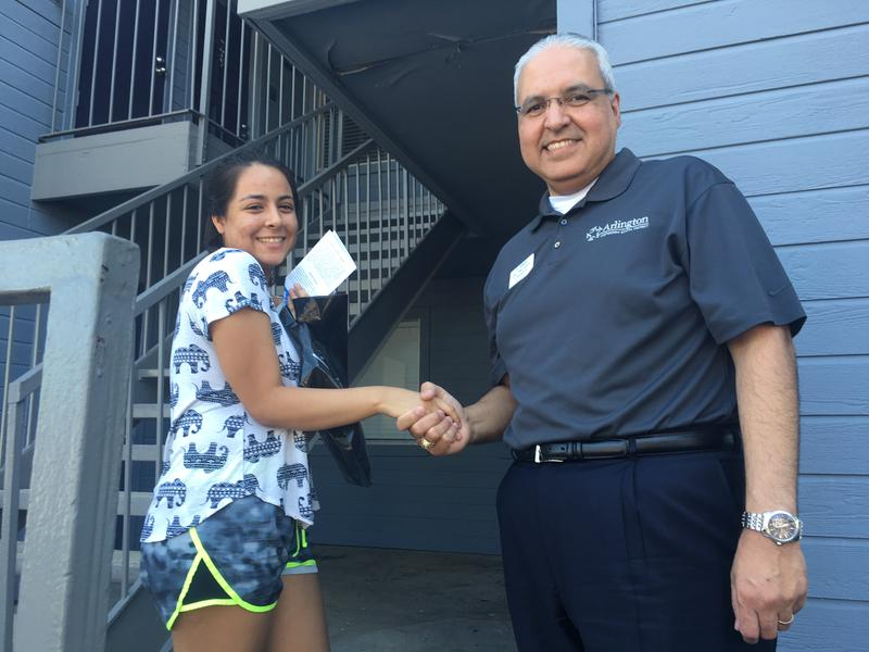 Arlington Independent School District Superintendent Marcelo Cavazos stands with Melissa Aguilar during Operation Graduation Walk last Saturday. Cavazos spent the morning visiting students like Melissa in an effort to convince them to return to school.