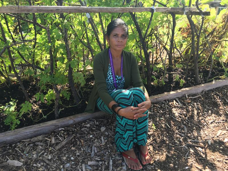 A resident of Vickery Meadow, Durga Lamichhaney, rests in the community garden.