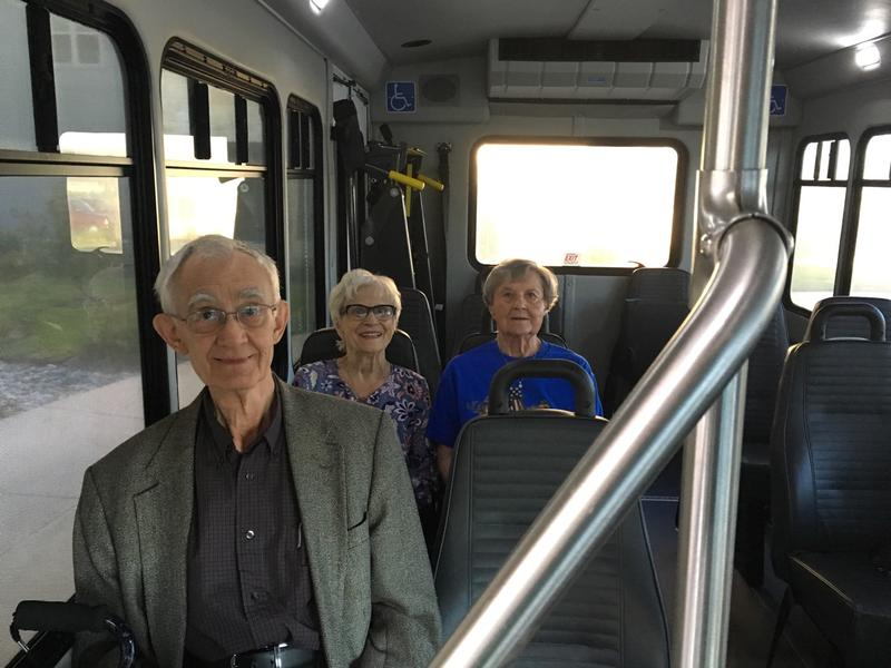 (From L to R): John Hoffman, Mary Fan Kain and Hazel Hollien ride the shuttle to the polls.