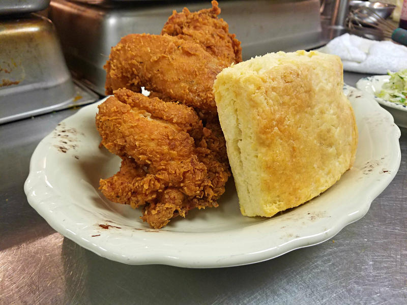 "The ""Sir Mix a lot"" at Whistle Britches includes three pieces of golden fried chicken with a side of potato salad and a homemade biscuit."