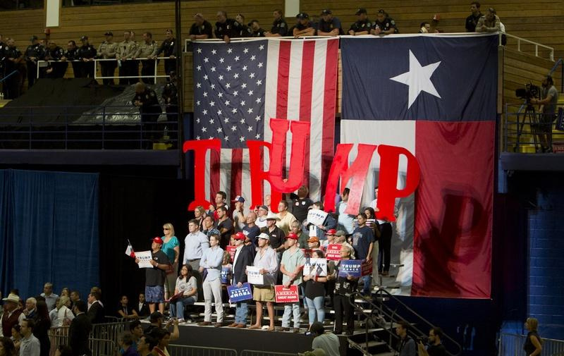 Supporters of Republican Presidential nominee Donald Trump, hold up letters to spell his name during an August 23, 2016 rally in Austin.