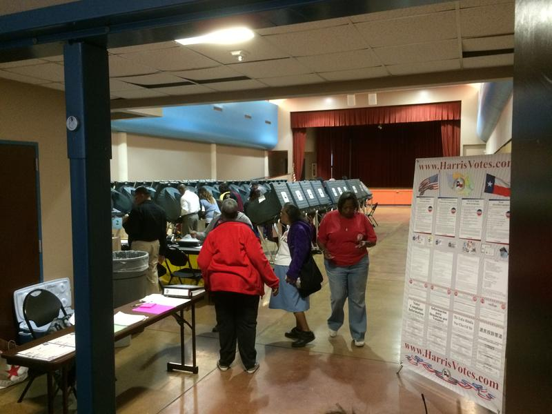 Early voters cast their ballots at Acres Homes Multi-Service Center.