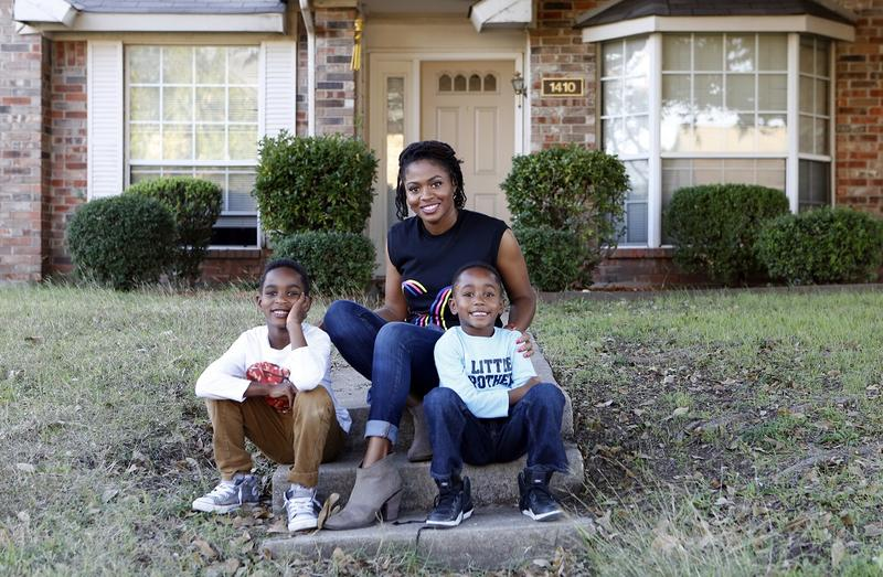 Jennifer Anderson and her two boys Jayden and Jordan outside their rental home in Garland.