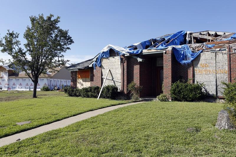 Nearly a year after the storms, a tornado-damaged house in Rowlett still hasn't been repaired.