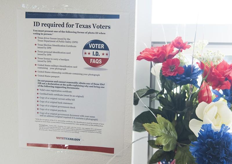 A copy of the new voter ID regulations is posted at a south Texas early voting location on October 26, 2016.