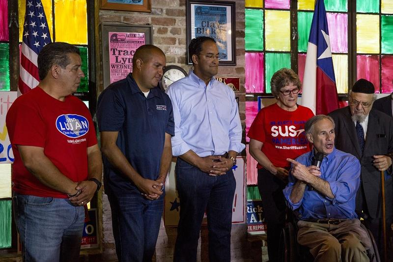 (L to R) State Reps. John Lujan and Rick Galindo and U.S. Rep. Will Hurd receive a last-minute campaign boost from Gov. Greg Abbott at The County Line barbecue restaurant in San Antonio on November 7, 2016.