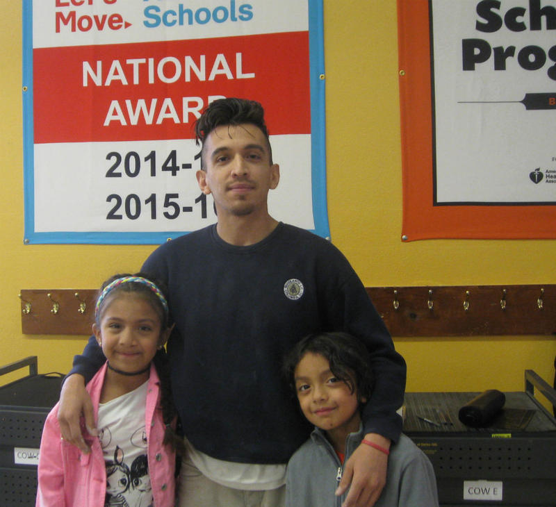 Andres Estrada and his daughters in Dan Rogers Elementary's cafeteria