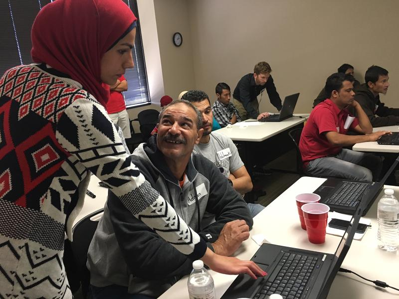 Umniy Ahaljandeel is an interpreter for the International Rescue Committee in Dallas. Over the weekend, she helped a group of refugees set up their new laptops and use English language software. Ahaljandeel arrived as a refugee from Iraq in 2004.