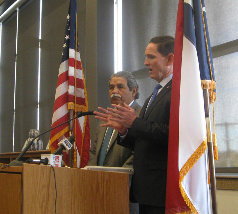"Dallas County Judge Clay Jenkins, at lectern, with Dallas Supterintendent Michael Hinojosa to his right. ""These recommendations will make our courts a more rarely used system of last resort."""