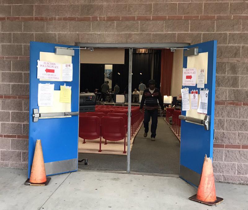"Voters cast their ballots in the auditorium of Esperanza ""Hope"" Medrano Elementary School in Dallas."