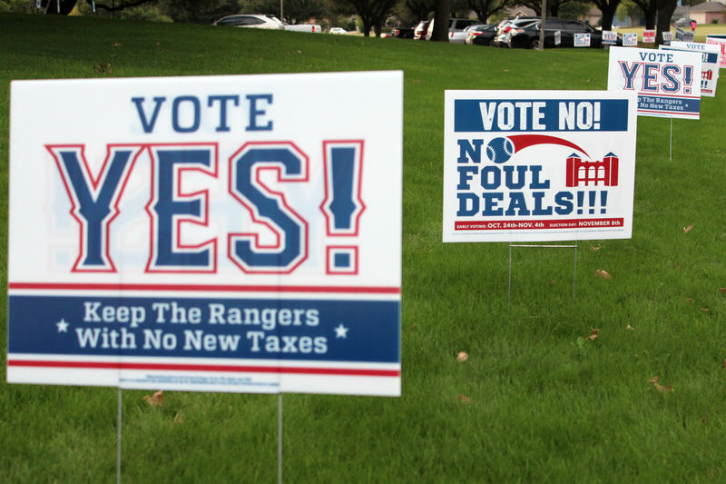 Signs in favor of and opposing a vote to use local tax dollars to help fund a new stadium for the Texas Rangers are all over early voting precincts in Arlington.