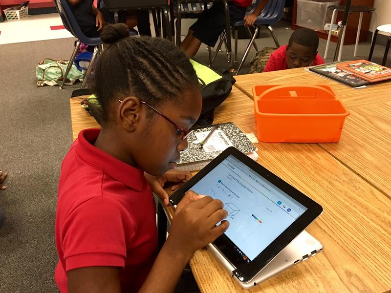 A fifth-grade student at McWhorter Elementary Schoo works on a math problem using a Chromebook.