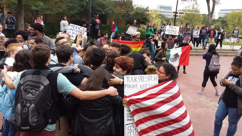 Students embrace in the University of North Texas' Library Mall Wednesday.