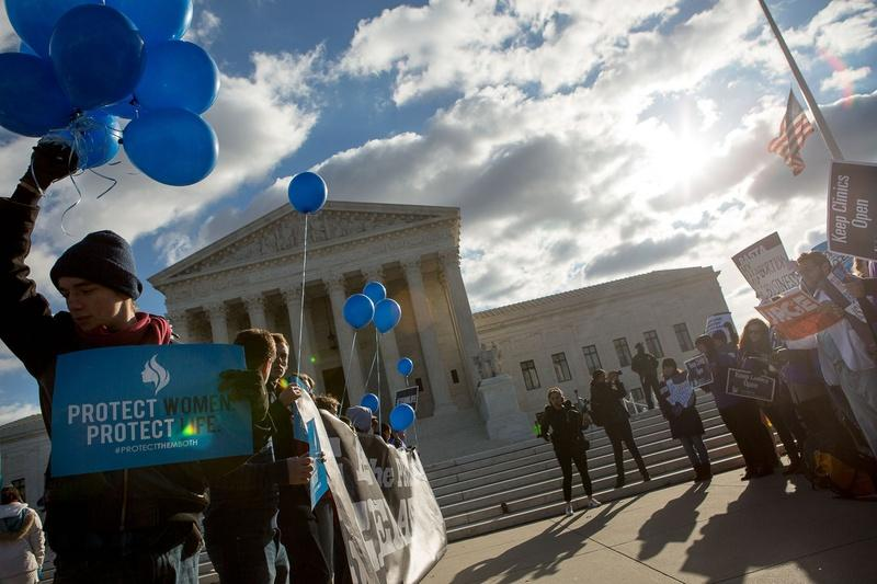 Protesters on both sides of the issue face off in front of the U.S. Supreme Court on Capitol Hill in Washington, D.C. as Whole Woman's Health v. Hellerstedt is argued inside, March 2, 2016.