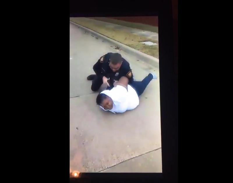 An identified Fort Worth police officer holds Jacqueline Craig on the ground. This image comes from a Facebook Live video that has since gone viral.