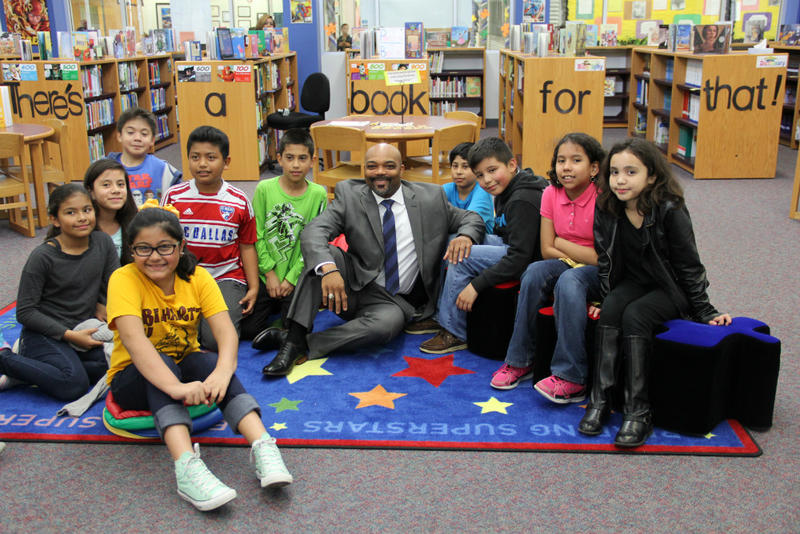 Duncanville Superintendent Marc Smith surrounded by students in the district he has led since April.