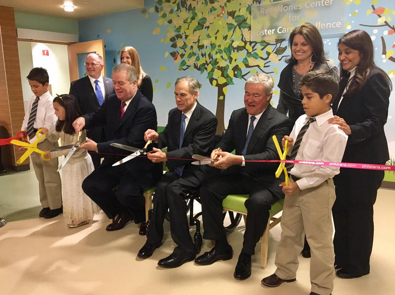 Children join officials, including Texas Gov. Greg Abbott, in cutting the ribbon for the new Rees-Jones Center for Foster Care Excellence at Children's Health.