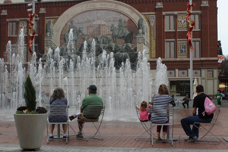 An unseasonably warm winter afternoon drew people to the fountains in Fort Worth's Sundance Square in December 2016.