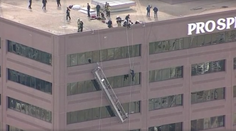 Dallas Fire-Rescue saved two window washers Wednesday afternoon after one side of their scaffold gave way about 12 stories up along a skyscraper in North Dallas.