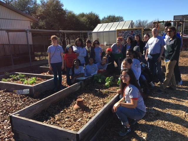 Americorps members pose in the Bayles Elementary Garden after spending MLK day improving it.
