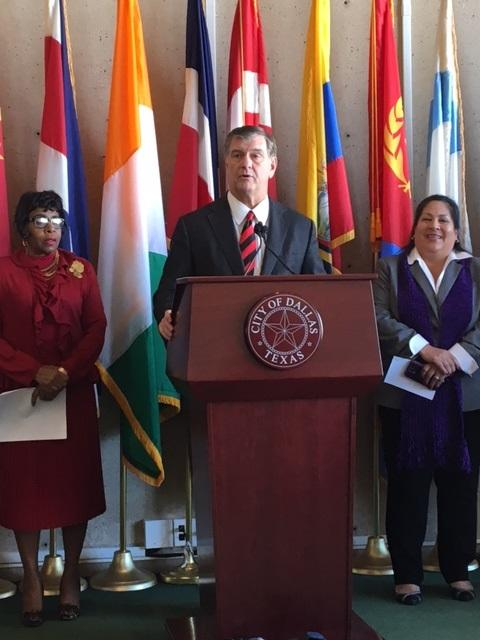 At a city hall news conference, Mayor Mike Rawlings announced that Catholic Charities Dallas will start canvassing the west Dallas neighborhood where 300 homes are slated for closure.