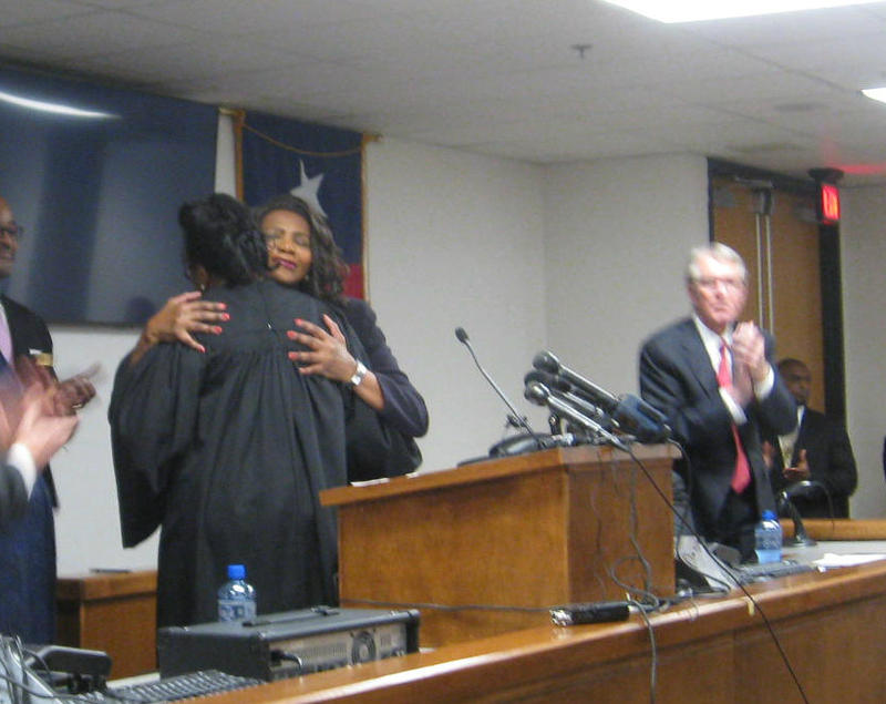 New Dallas County District Attorney Faith Johnson - facing us - gets a hug from Caroline Wright, who just swore her in.
