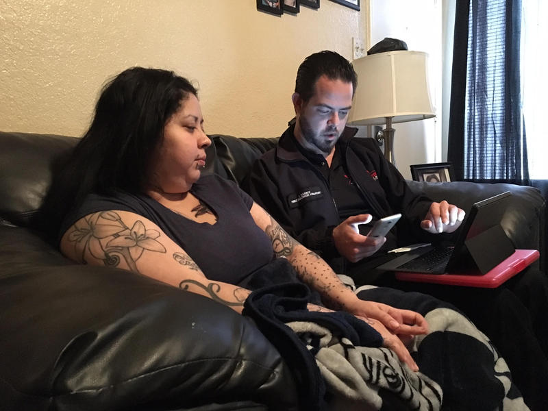Sandra Guevara talks with John Farris, a community paramedic who works for MedStar in Fort Worth.