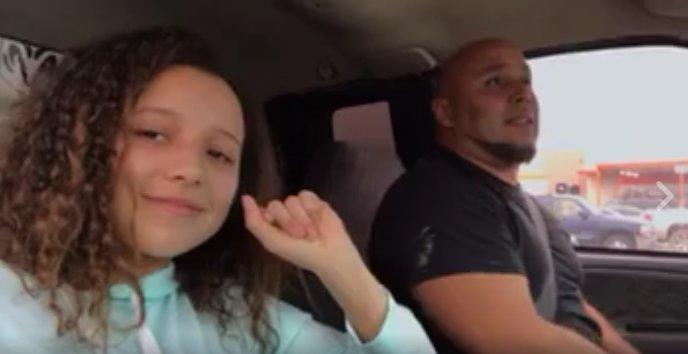 """The video of Kris Jones (right) singing """"Tennessee Whiskey"""" has gone viral. The video was shot by his 15-year-old daughter (left)."""