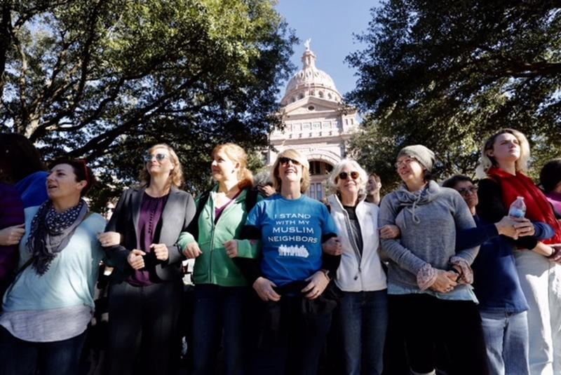 Supporters create a human shield for participants attending Texas Muslim Capitol Day on Tuesday.
