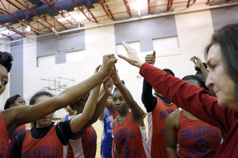 Head coach Cathy Self-Morgan gives her team high-fives after practice at Duncanville High School.